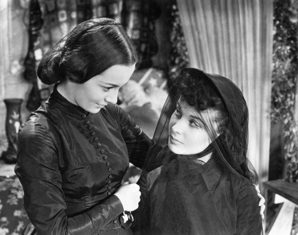 Olivia de Havilland (left) with Vivian Leigh in a scene from 'Gone With The Wind'