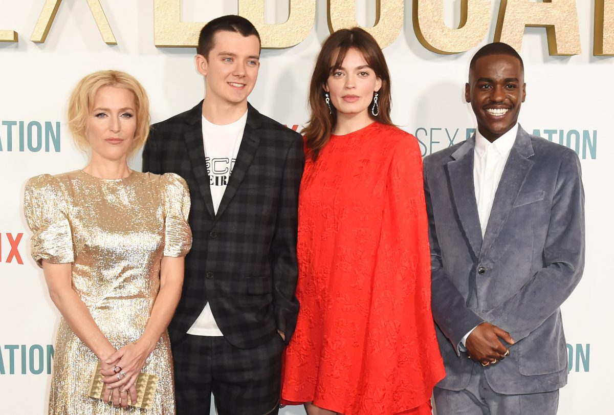 Gillian Anderson, Asa Butterfield, Emma Mackey and Ncuti Gatwa pose for photographers at the premiere of 'Sex Education' Season 2