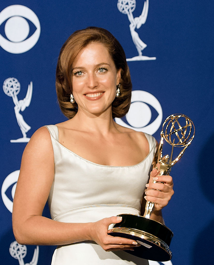 The X-Files cast member Gillian Anderson with her Emmy award
