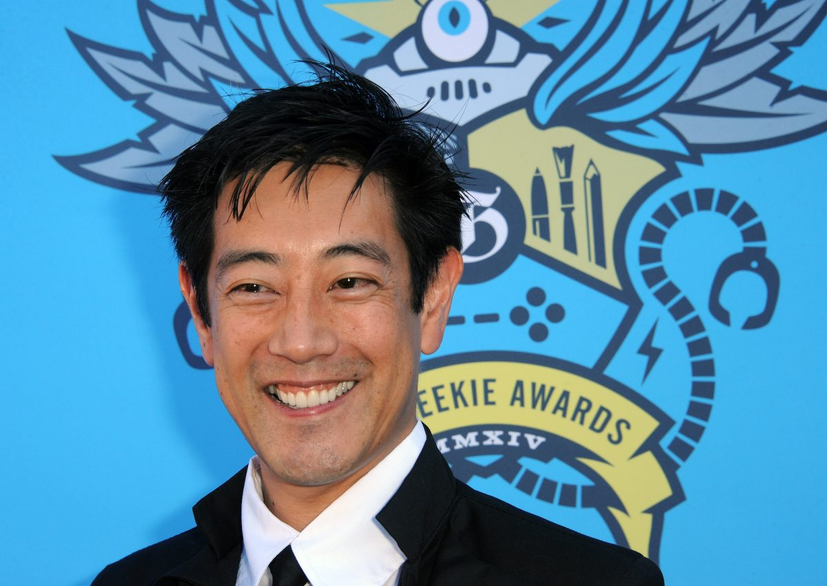 Grant Imahara poses for photographers as he arrives at the 2014  Geekie Awards