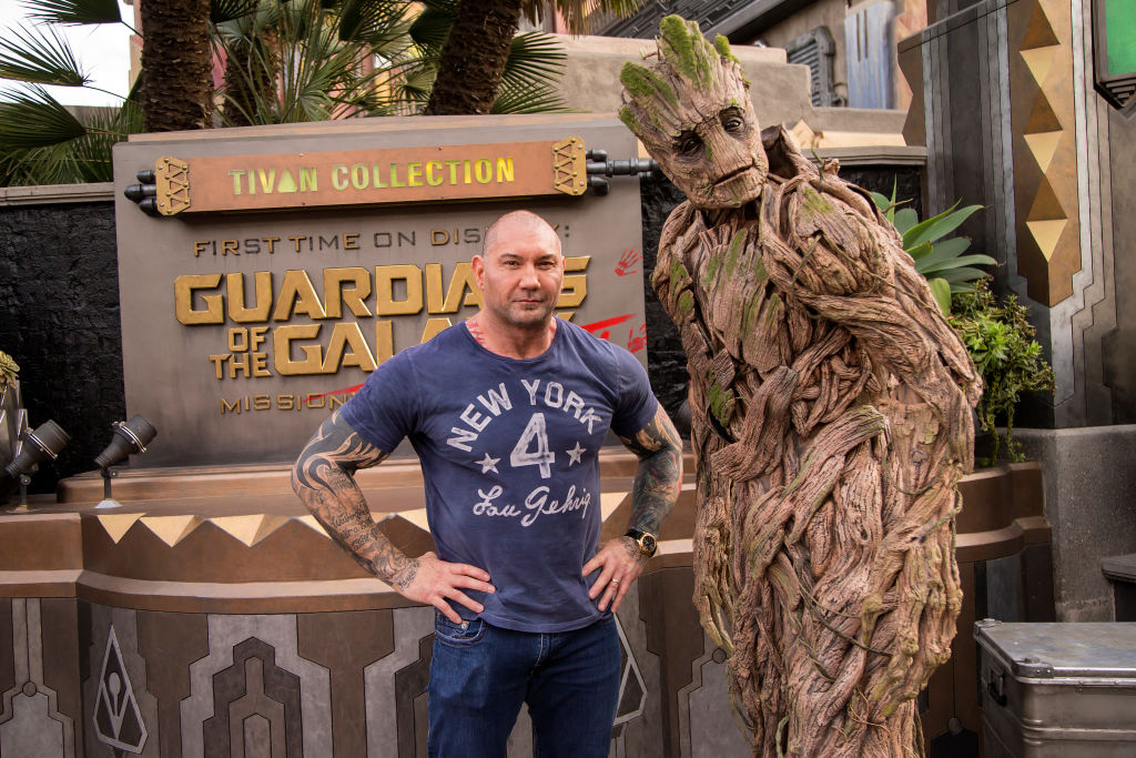 Actor Dave Bautista poses with Groot outside the Guardians of the Galaxy - Mission: BREAKOUT! attraction