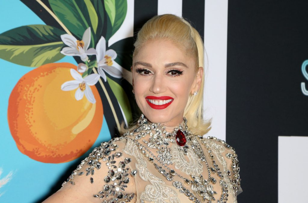 Gwen Stefani in full makeup and red lipstick