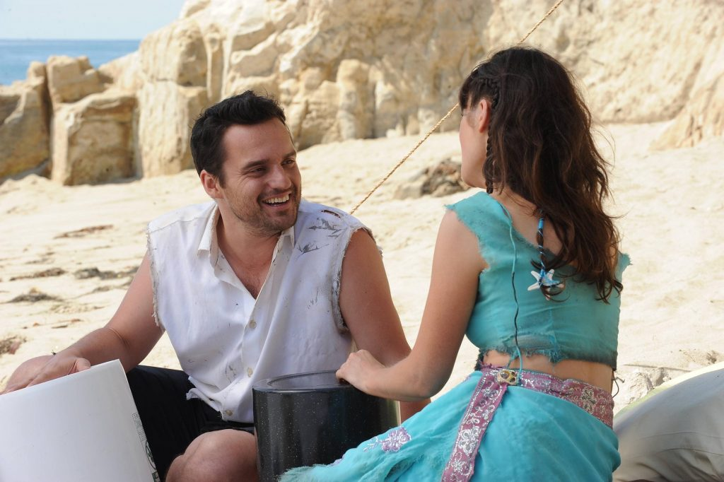 Jake Johnson as Nick Miller and Zooey Deschanel as Jessica Day