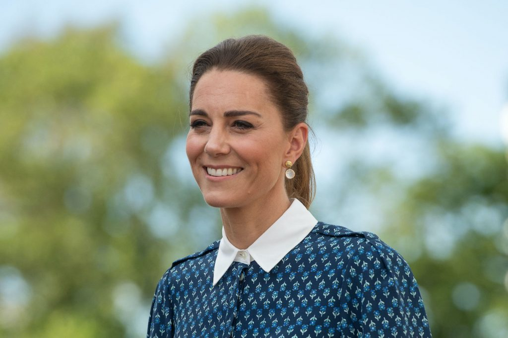 Kate Middleton smiles during a visit to the Queen Elizabeth Hospital