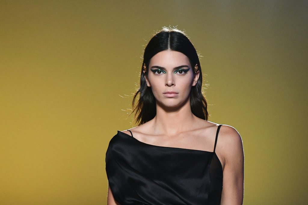Kendall Jenner walking on a runway not smiling