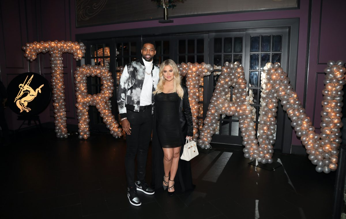 Khloé Kardashian and Tristan Thompson pose together at a party