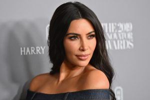 Why Kim Kardashian Has Someone Remove the Cardboard Sleeve of Her Coffee For Her
