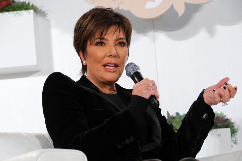 Kris Jenner talking into a microphone