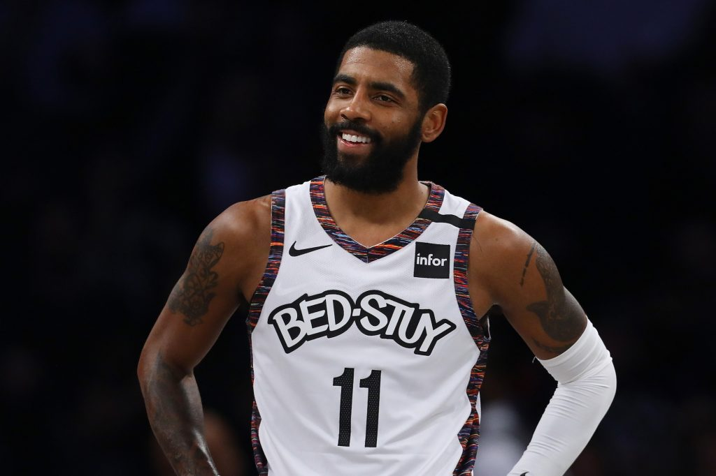Kyrie Irving smiling on the court