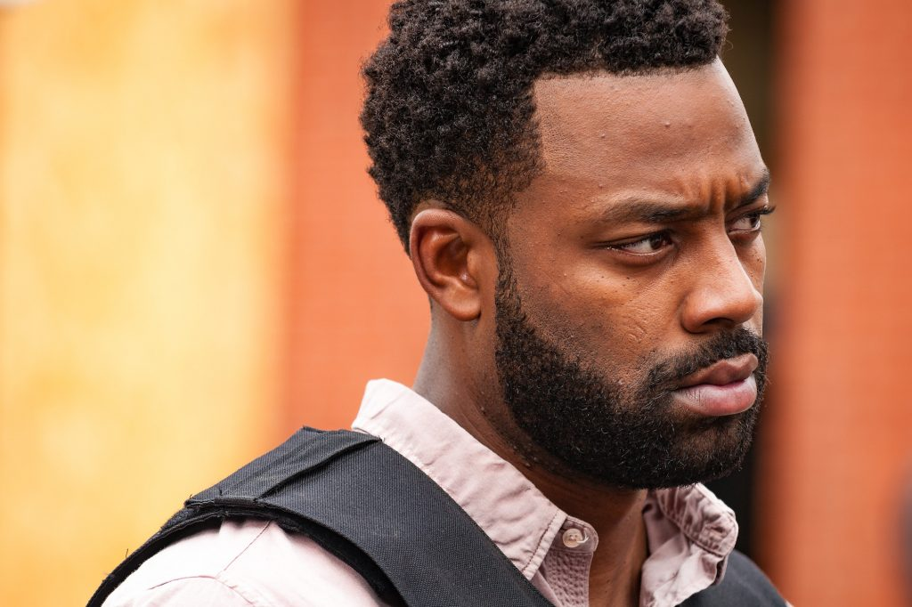 LaRoyce Hawkins as Officer Kevin Atwater looking away from the camera