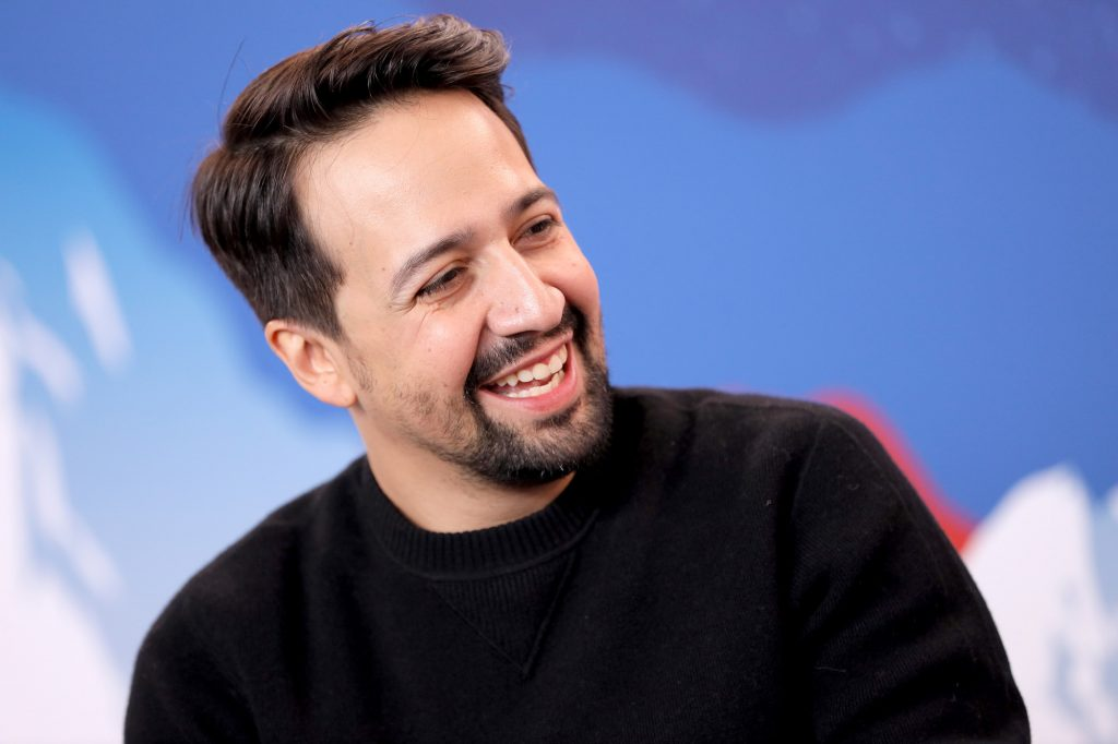 Lin-Manuel Miranda turned to the side, laughing