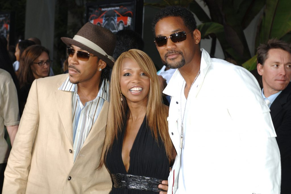 Ludacris, Elise Neal, and Will Smith on the red carpet