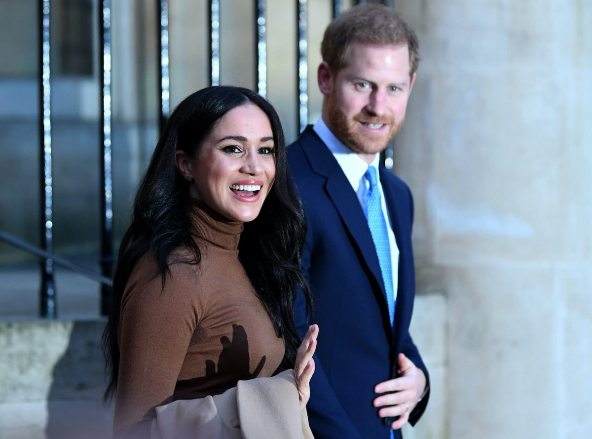 Meghan Markle waves to crowds as she and Prince Harry leave Canada House