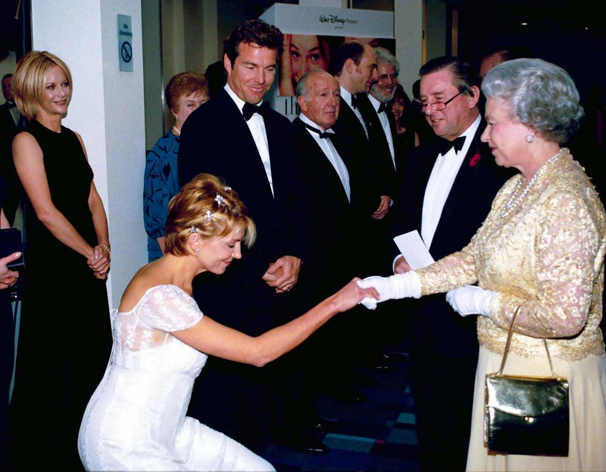 Natasha Richardson curtseying to Queen Elizabeth II at 'The Parent Trap' Premiere