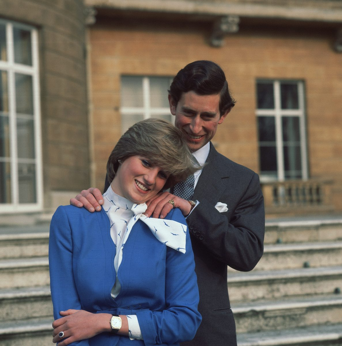 Prince Charles and Princess Diana pose for photos after announcing their engagement