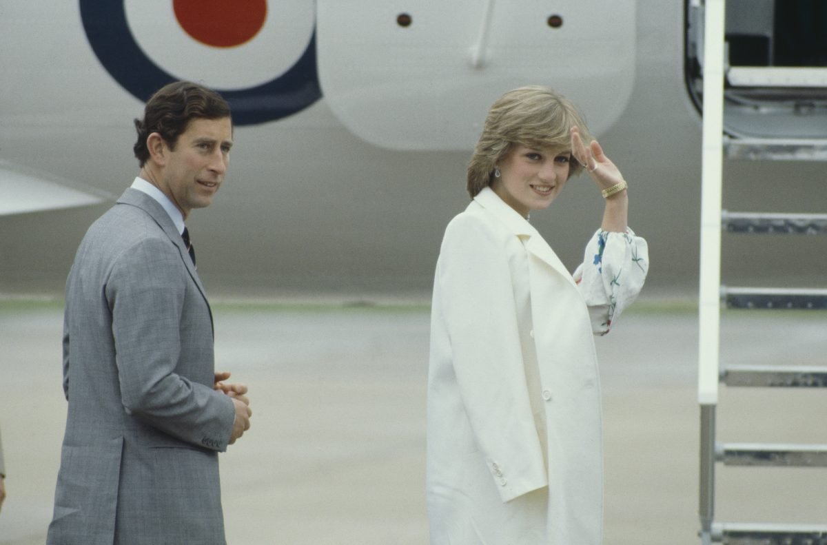 Princess Diana waves as she and Prince Charles get on a plane at the start of their honeymoon