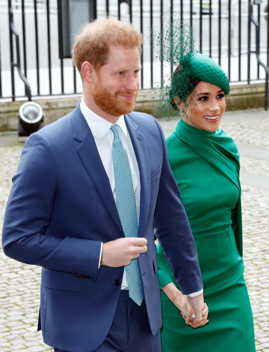 Prince Harry and Meghan Markle hold hands as they arrive at the 2020 Commonwealth Day Service