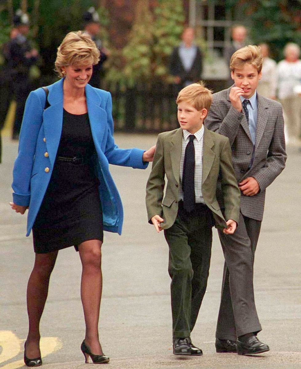 Princess Diana walking with her sons, Prince Harry and Prince William