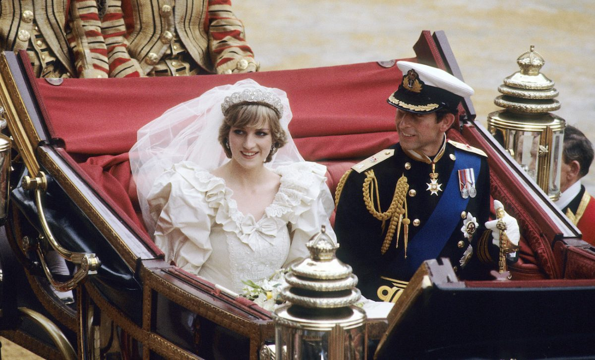 Princess Diana and Prince Charles ride in a carriage at their royal wedding