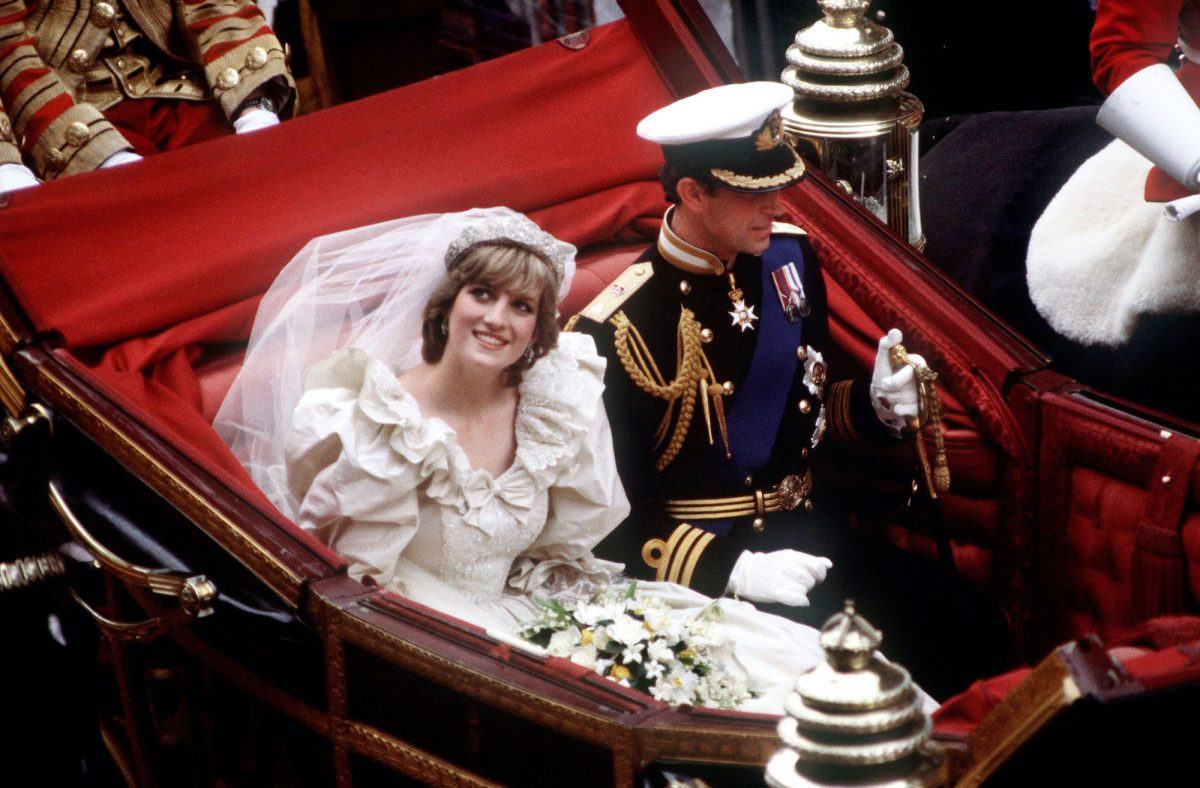 Princess Diana and Prince Charles ride in a carriage back to Buckingham Palace following their 1981 royal wedding