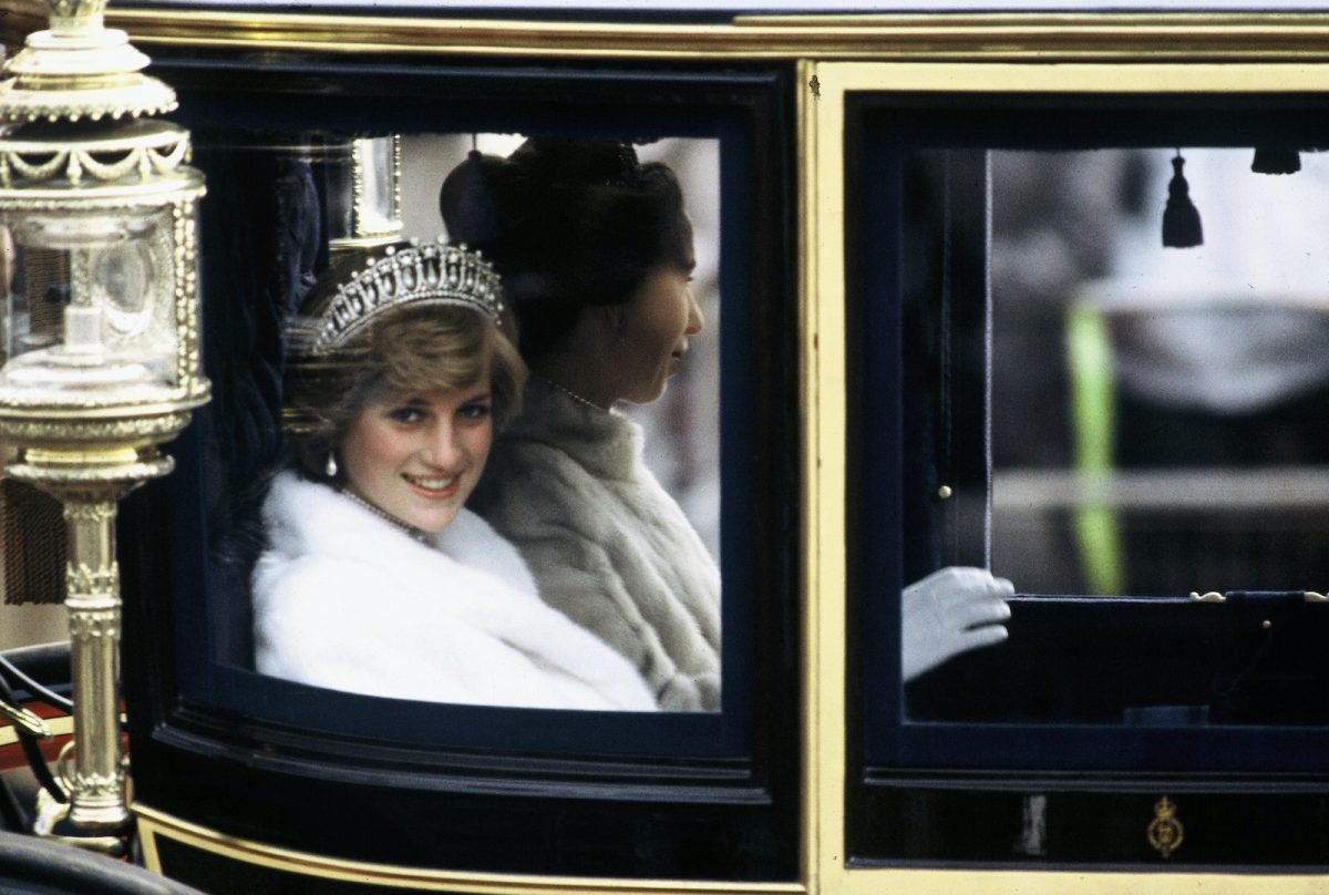 Princess Diana rides in a carriage to the opening of Parliament with Princess Anne