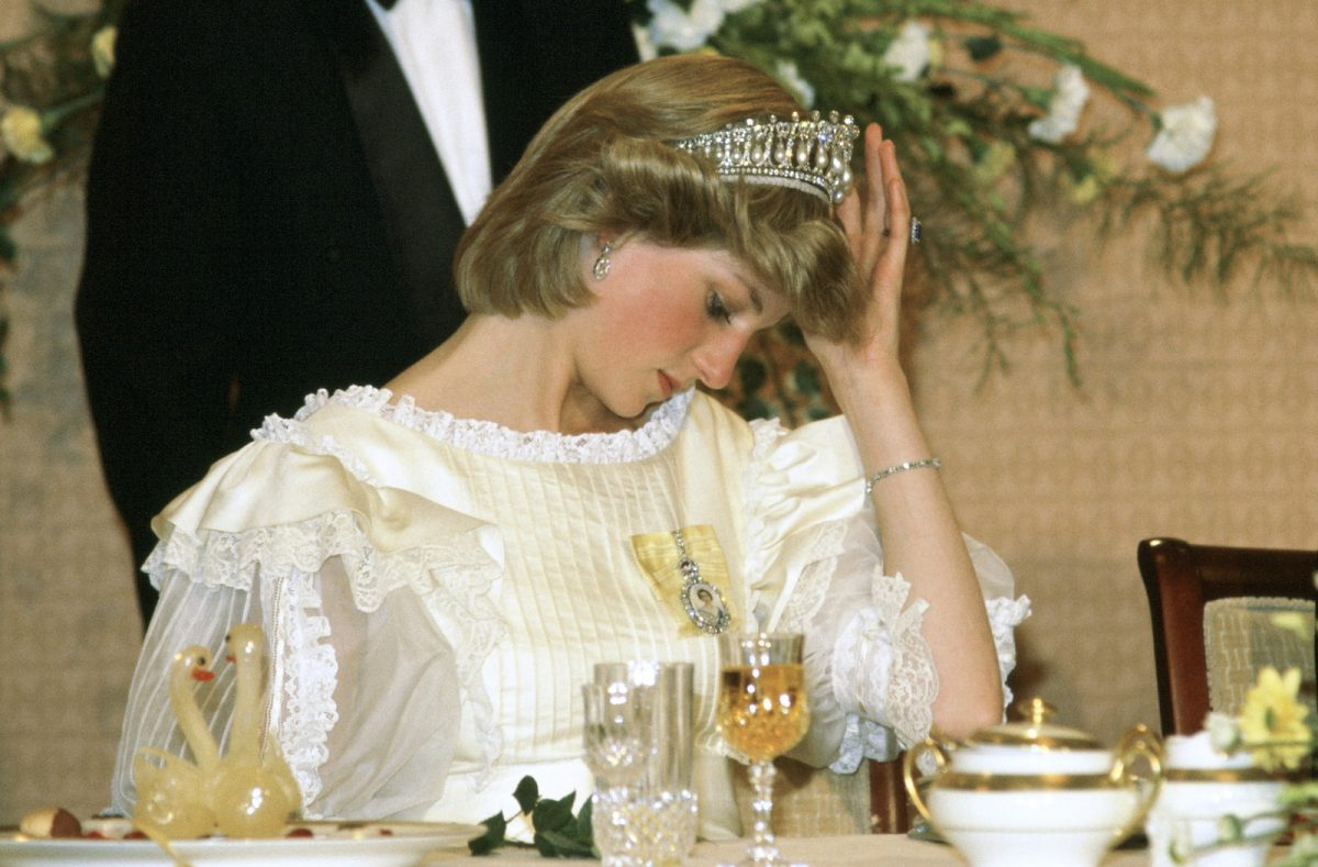 Princess Diana in New Zealand adjusting the Lover's Knot Tiara
