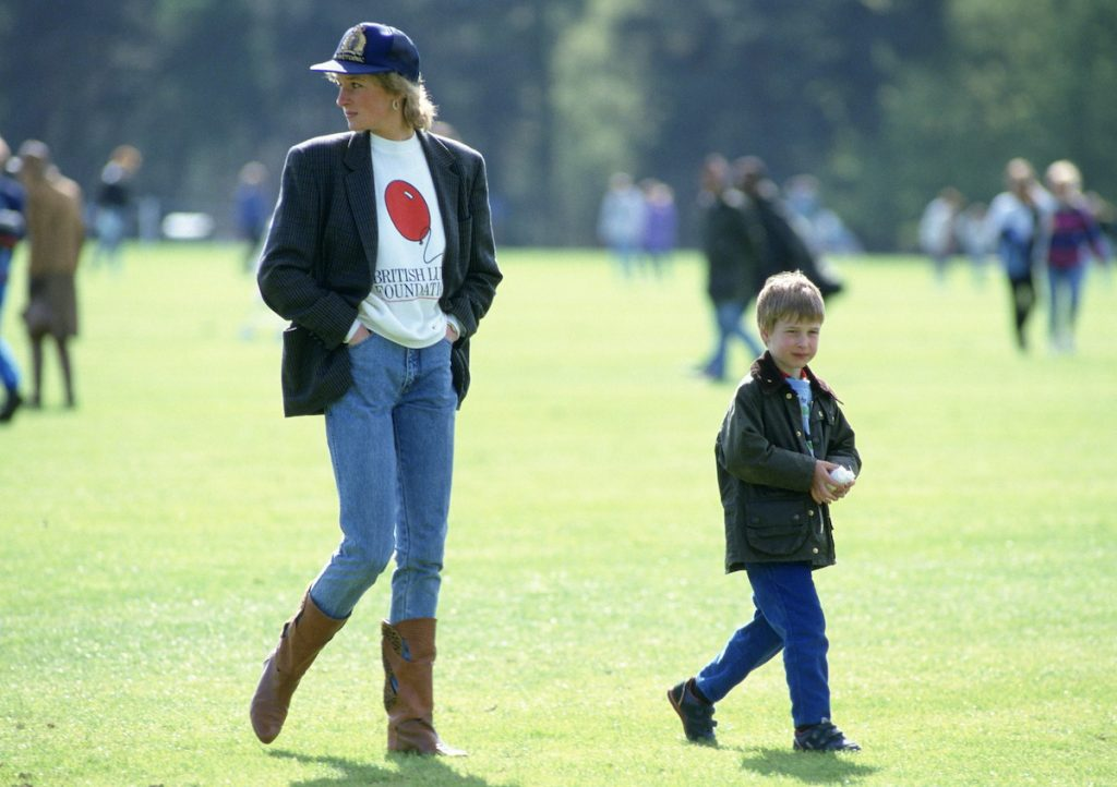 Prince William With His Mother, Diana, Princess Of Wales At Guards Polo Club. The Princess Is Casually Dressed In A Sweatshirt With The British Lung Foundation Logo On The Front Of Her T-shir