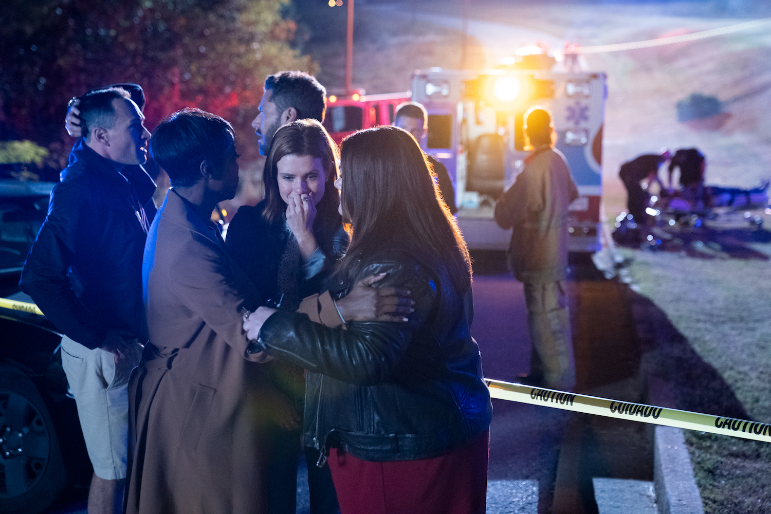 Crying JoAnna Garcia is embraced by her friends at the scene of a car accident in Sweet Magnolias