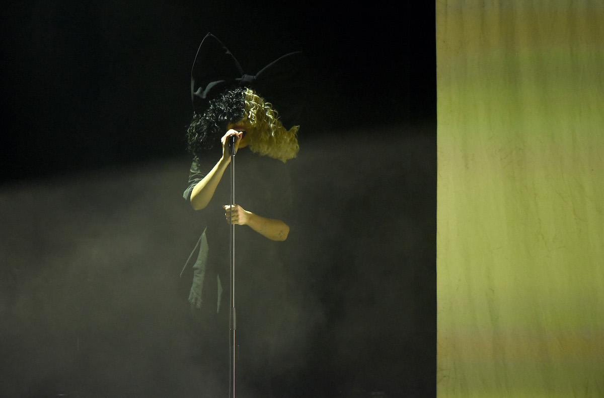 Sia performs onstage  Los Angeles LGBT Center
