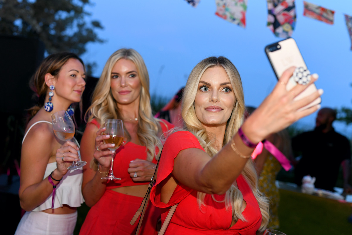 Ashley Wirkus and Lauren Wirkus pose for a selfie during Camilla Miami Swim Week