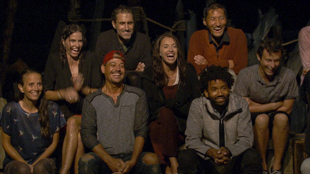 Amber Brkich Mariano, Danni Boatwright, Boston Rob Mariano, Ethan Zohn, Parvati Shallow, Yul Kwon, Wendell Holland and Adam Klein laughing at a tribal council