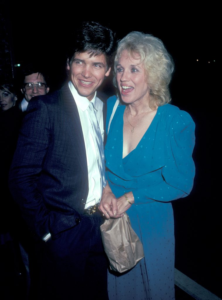 Michael Damian and Carolyn Conwell smiling looking away from the camera