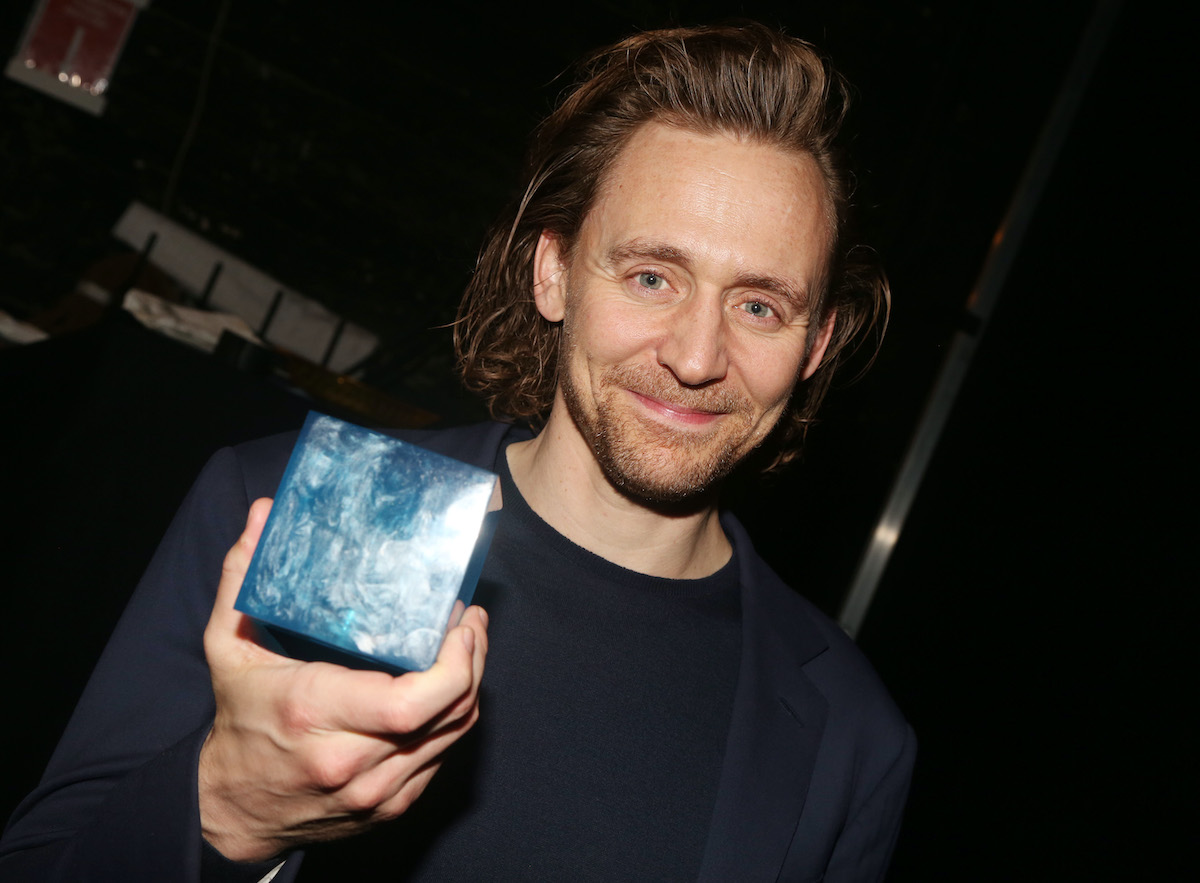 """Tom Hiddleston poses with the """"Tesseract Blue Infinity Stone"""""""