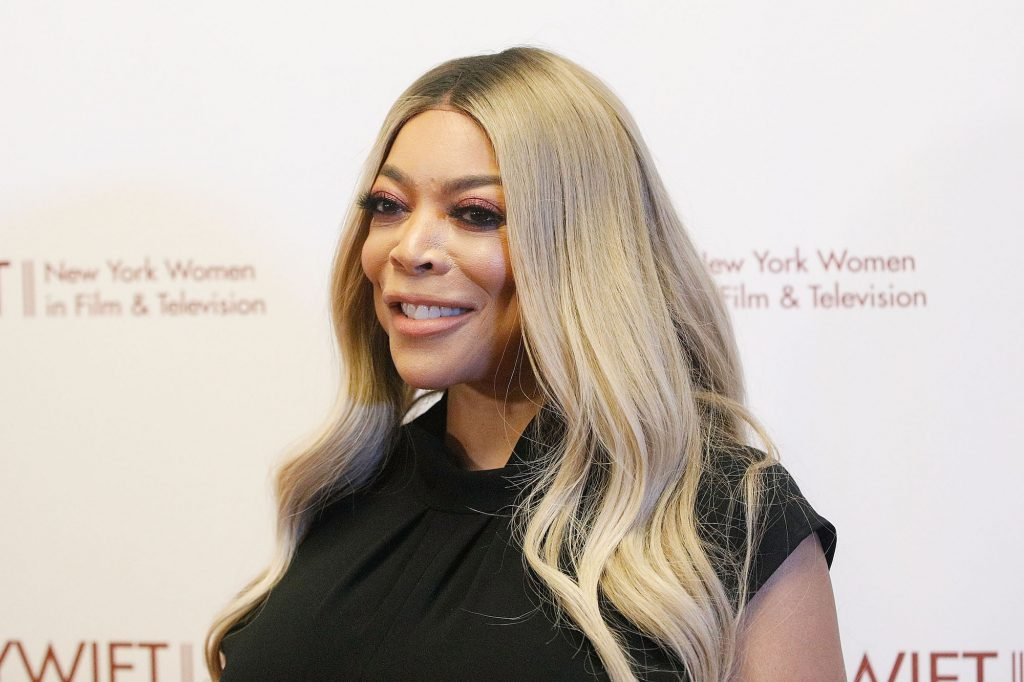 Wendy Williams smiling, turned to the left