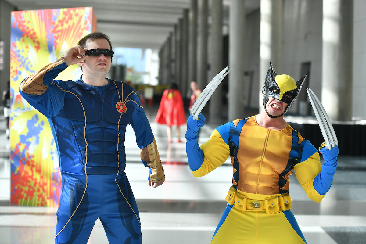 Fans cosplay as X-men's Cyclops and Wolverine