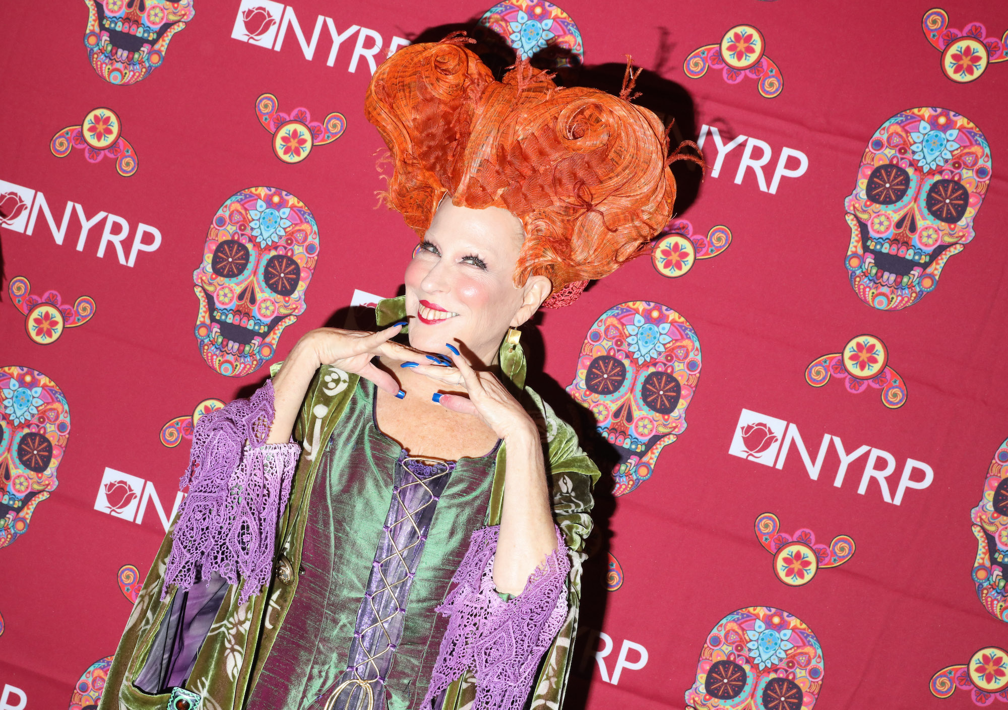 Bette Midler dressed as Winifred Sanderson from 'Hocus Pocus' on the red carpet at Bette Midler's annual Hulaween Bash on October 28, 2016.