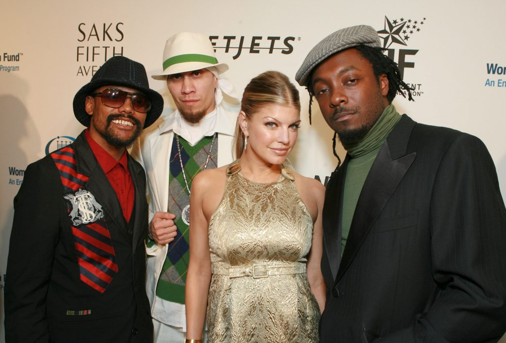 The BLack Eyed Peas in front of a white backdrop