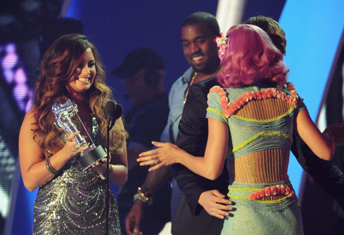 Singers Kanye West, Demi Lovato and Katy Perry speak onstage during the 2011 MTV Video Music Awards at Nokia Theatre L.A. Live on August 28, 2011 in Los Angeles, California.