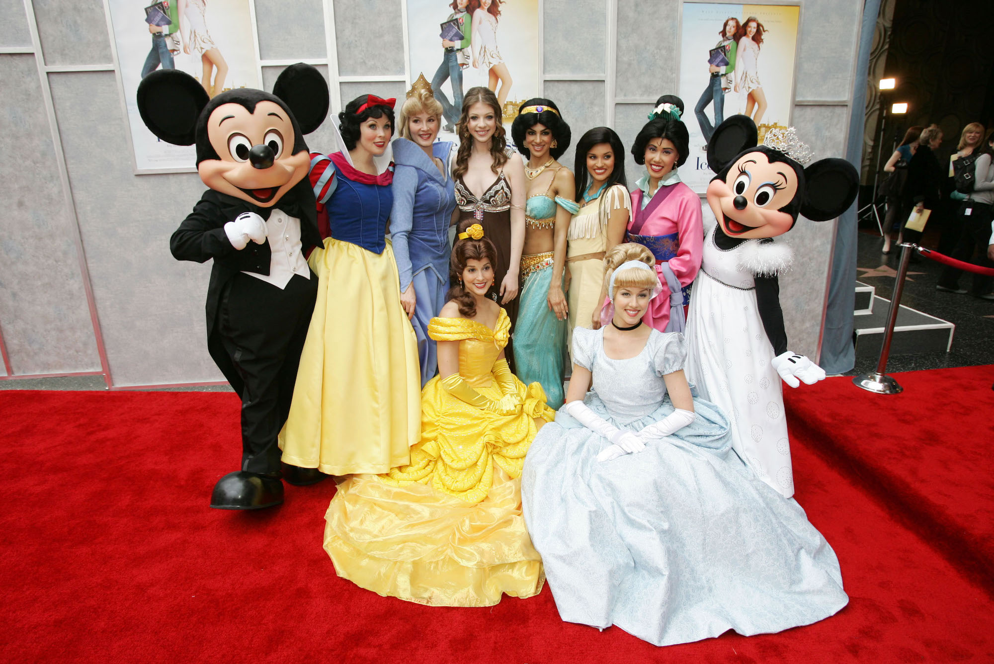Michelle Trachtenberg poses with Disney princesses at the Walt Disney premiere of 'The Ice Princess' on March 13, 2005