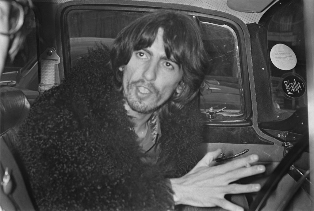 George Harrison sitting in his car in 1969