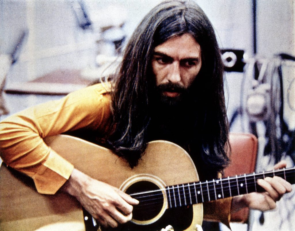 George Harrison holding a guitar