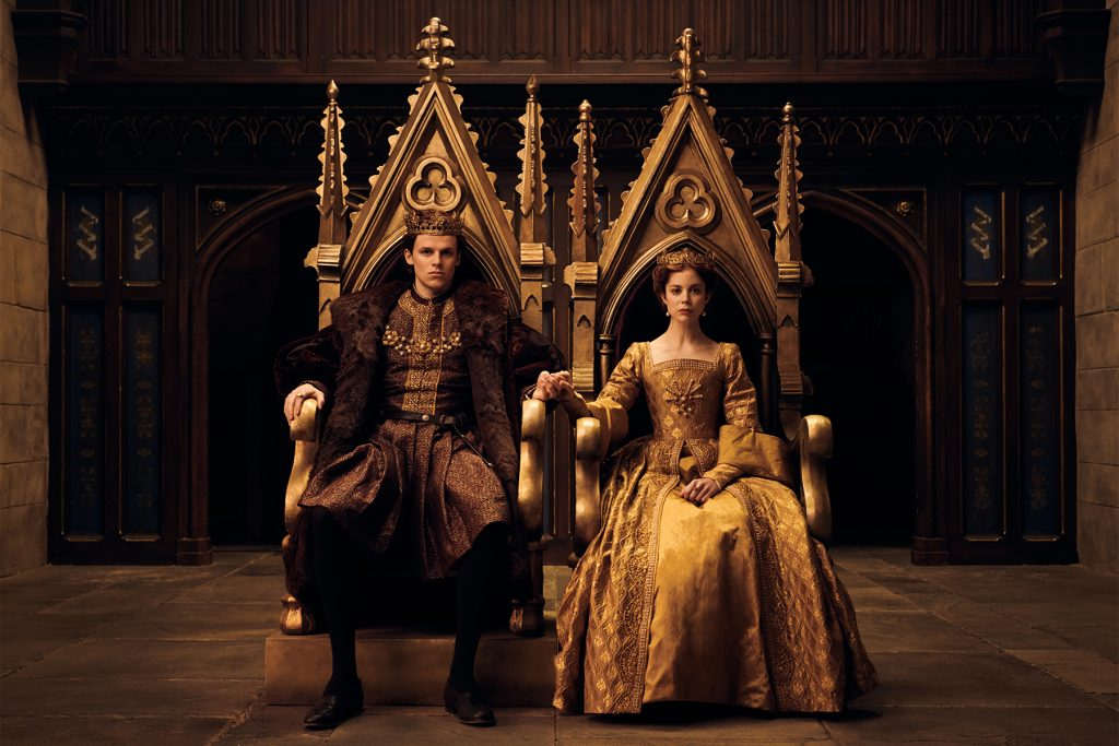 Henry and Catherine sitting on thrones