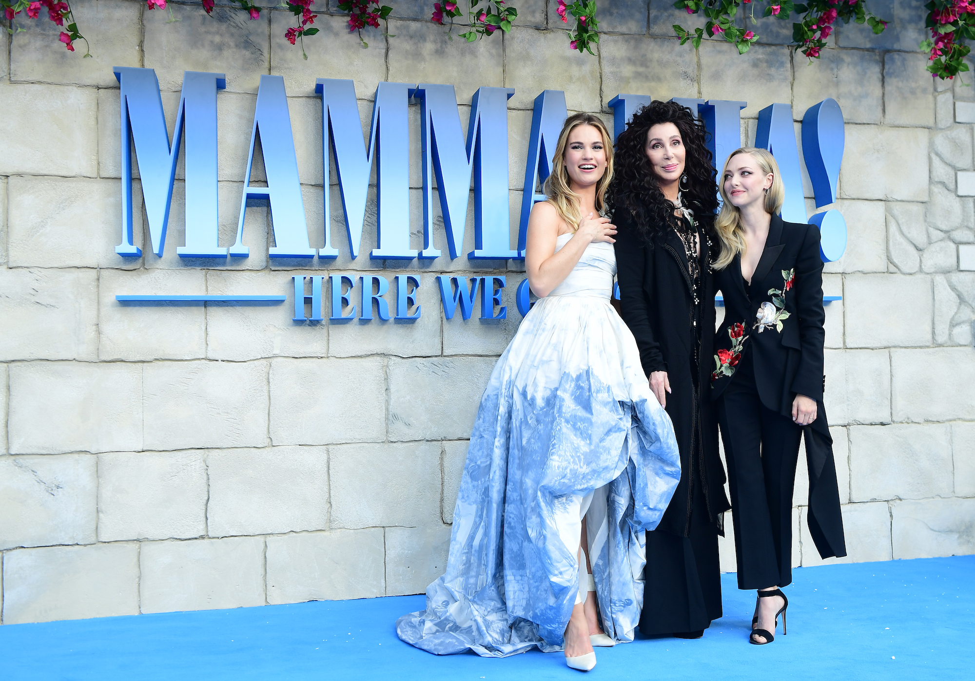 Lily James, Cher, and Amanda Seyfried at the premiere of 'Mamma Mia! Here We Go Again' on July 16, 2018.