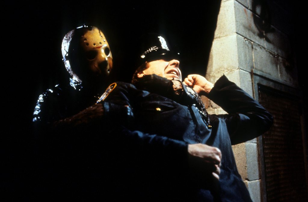Jason Vorhees from the Friday the 13th films with a cop