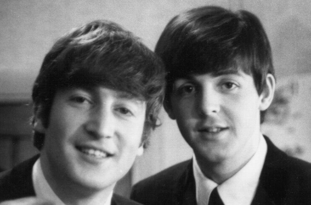 John Lennon and Paul McCartney with mop top haircuts