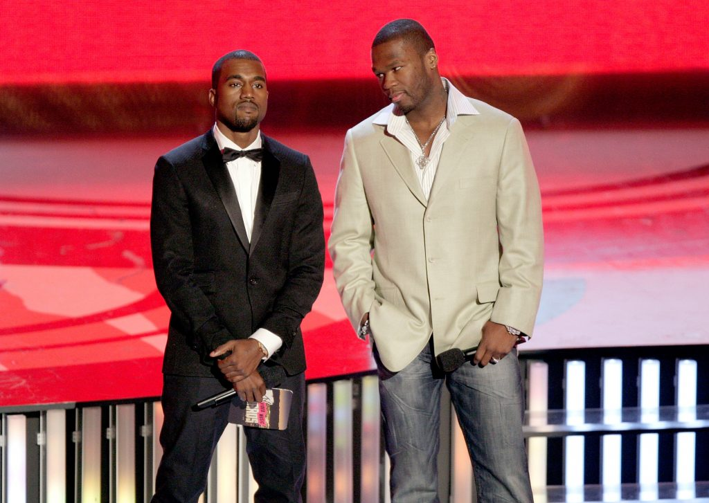 Kanye West standing next to 50 Cent