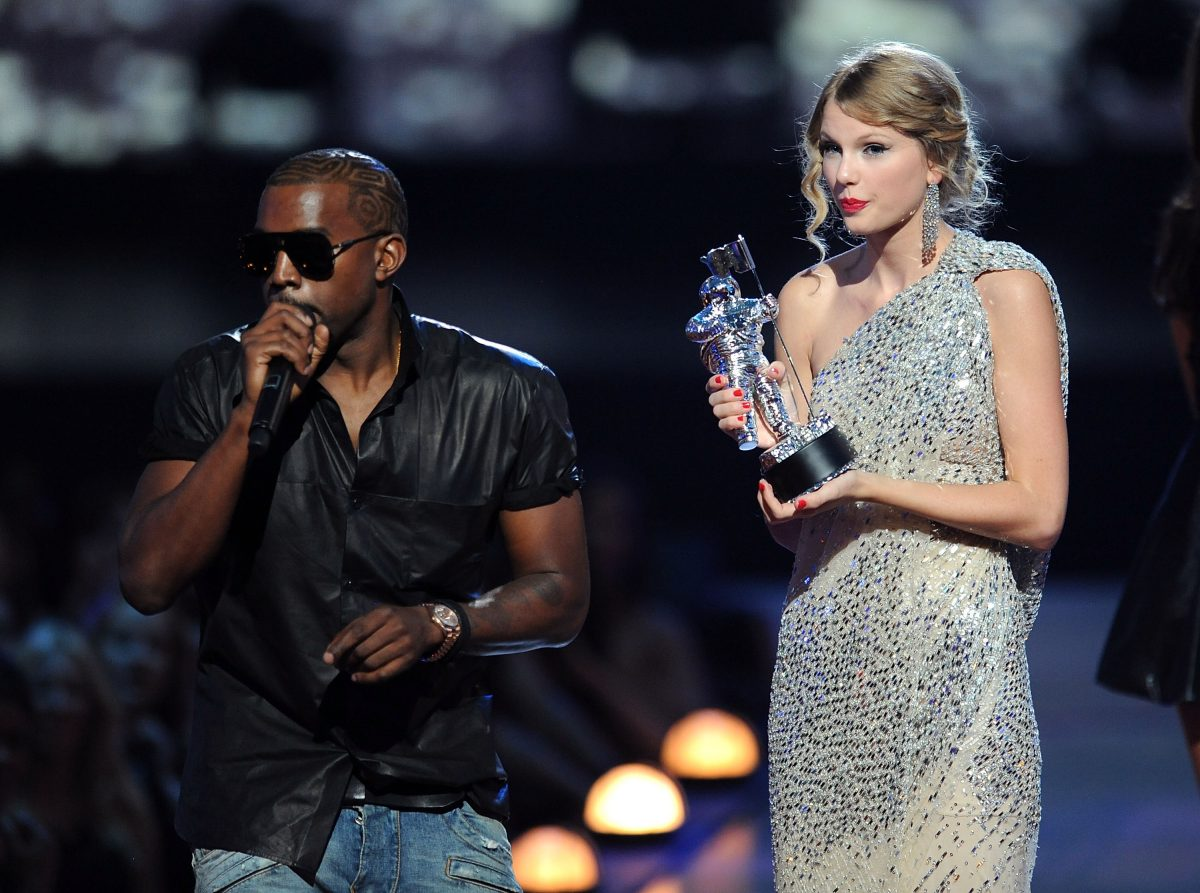 Kanye West takes the microphone from Taylor Swift at the MTV Video Music Awards 2009 on September 13, 2009 in New York.