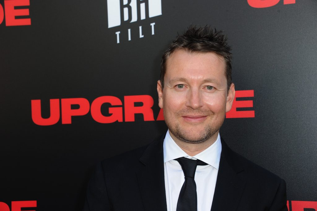 Leigh Whannell in a suit and tie