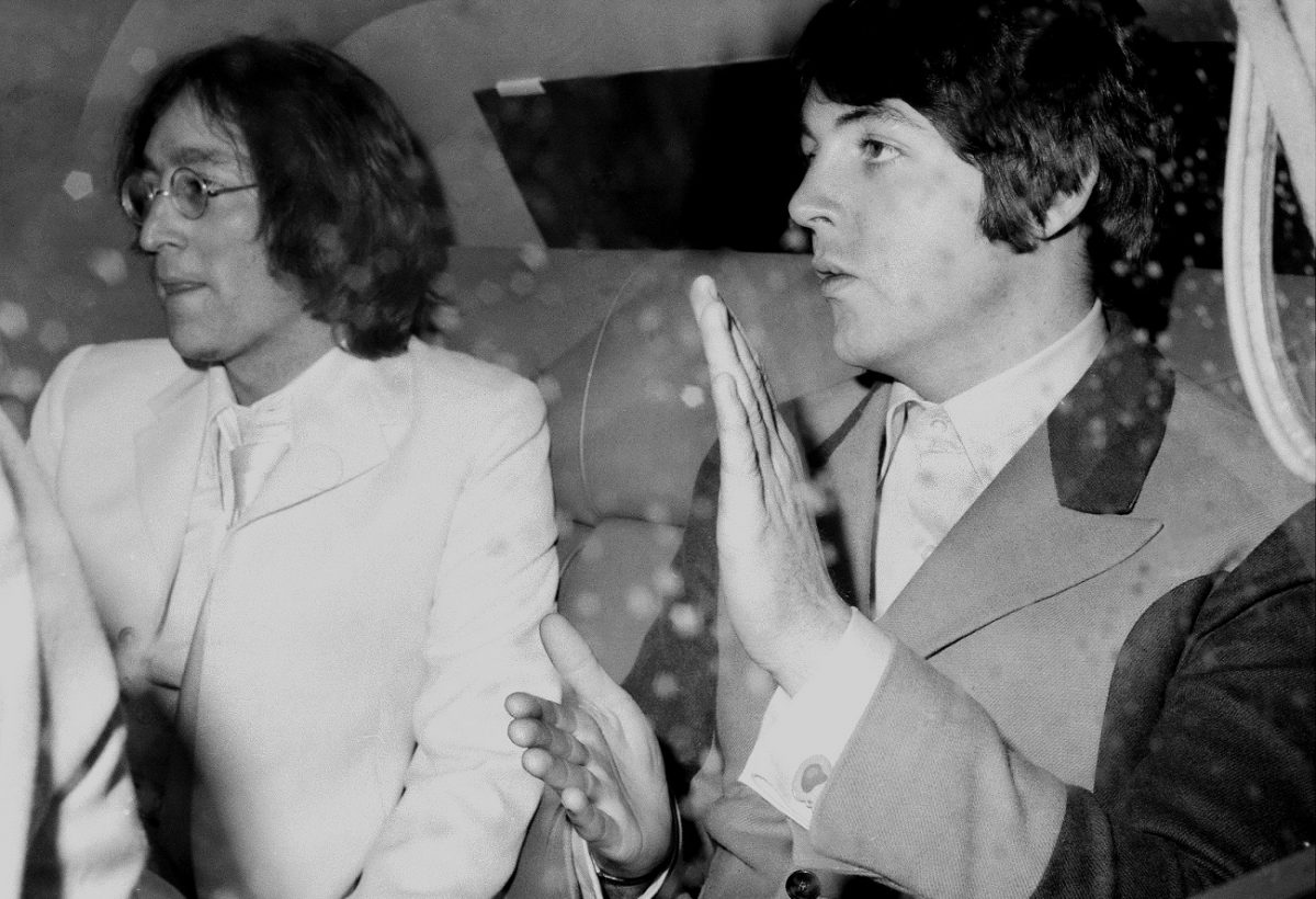 Lennon and McCartney in a limo at JFK airport