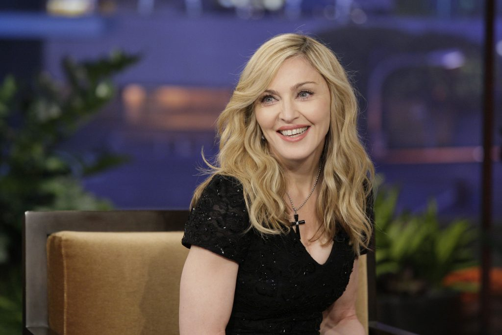 Madonna wearing a cross necklace